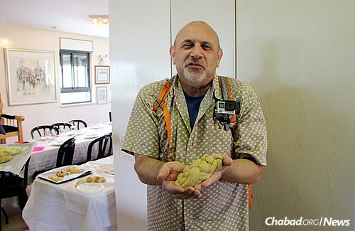 Eric Suris displays the challah he made in a baking class before Shabbat.