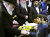 The Rebbe Distributing Charity