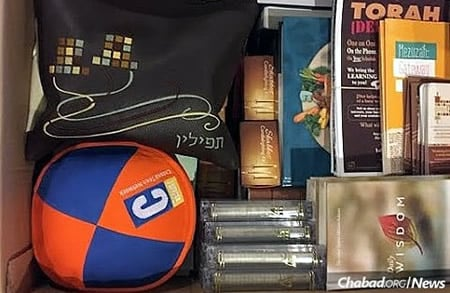 Armed with a box of vital items for those they met: tefillin, kipahs, mezuzahs, books and more.