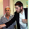 Only Surviving Boy Born in Auschwitz, Now 70, Puts on Tefillin for the First Time