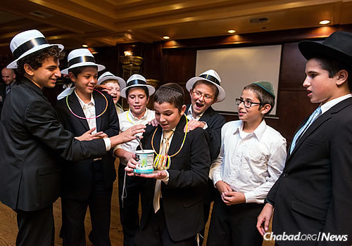 Mendel Cotlar, center, and Mendel Lazaroff, to his right in the green kipah, who recently made a recording to memorialize his friend and to help fund research for a cure for GSD. (Photo: Levikfoto)