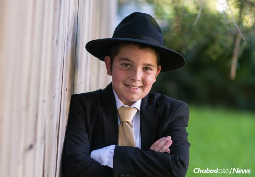 Mendel Cotlar, smiling on his bar mitzvah day, passed away just a few weeks later from the metabolic disease GSD. (Photo: Levikfoto)