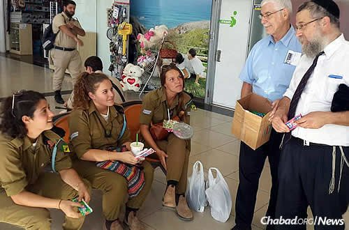 Rabbi Sholom Raichik, director of Chabad of Upper Montgomery County in Gaithersburg, Md., with IDF soldiers.