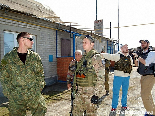 Sokol, far right, at a Ukrainian military position near the southeastern city of Mariupol.