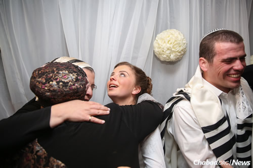 Sarah Techiya and Ariel Biegel under the chuppah immediately after their marriage. (Photo: Hadas Porush/Flash90)