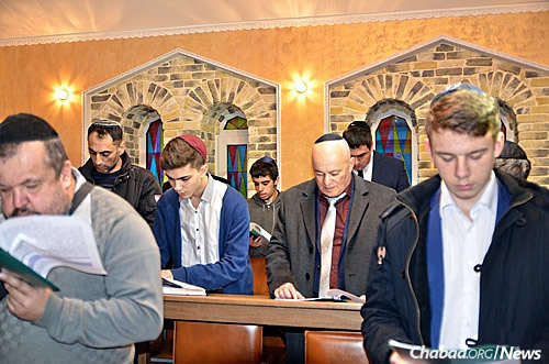 Men of all ages pray in the latest new synagogue serving Russian Jewry.