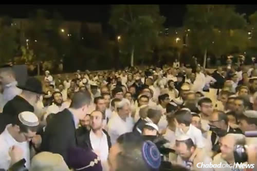 Thousands dance outside as the wedding celebration filled the International Convention Center in Jerusalem.