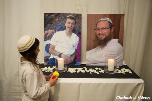 A memorial to the bride's father, Rabbi Yaakov Litman, right, and her 18-year-old brother Netanel, who were recently slain by terrorists. (Photo: Hadas Porush/Flash90)