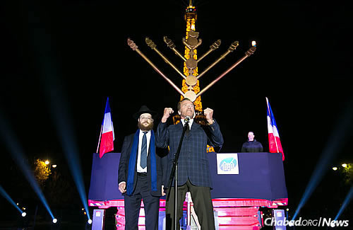 "Arnold Schwarzenegger, well-known actor and former governor of California, makes a guest appearance in Paris and wishes all a ""Happy Chanukah!"" (Photo: Thierry Guez)"