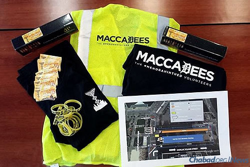 "A variety of gear from the Michigan-based Company Folders, Inc., was provided to event volunteers, called ""MaccaDees,"" who worked behind the scenes to make the downtown event run smoothly."