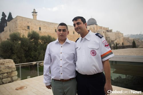 Naor with David Dalfon, a paramedic with the Magen Dovid Adom emergency rescue service who was the first responder at the scene and is credited with saving the young man's life.