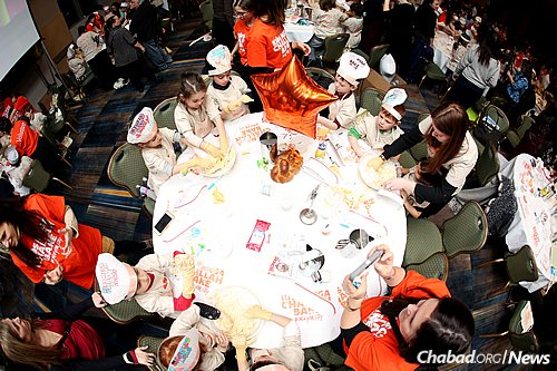 """A record-breaking 1,128 children and 316 adults came together for the first-ever local """"Kids Mega Challah Bake,"""" which took place at the New York Hilton in Midtown Manhattan. (Benams Photo)"""