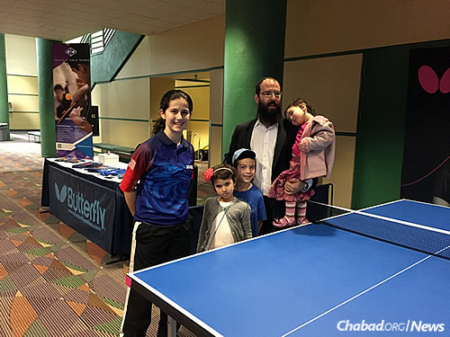 Estee with Rabbi Yosef Plotkin, co-director of Chabad-Lubavitch of Greensboro, N.C., and three of his four children who came to cheer her on. The Ackermans make a habit of eating and staying with Chabad families when Estee travels for competitions.