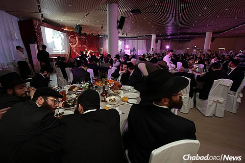 Participants at a banquet that followed the gathering of Chabad emissaries in Moscow.