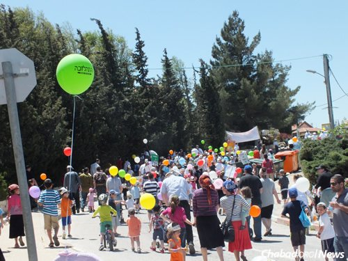 Last year in Yesod Hama'ala, little pieces of paper were distributed to children, who were asked to write down what they would like G-d to provide for them. They stuck those wishes to balloons that were then released into the air.