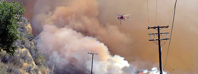 North America: As California Wildfires Rage, Close Calls for Many