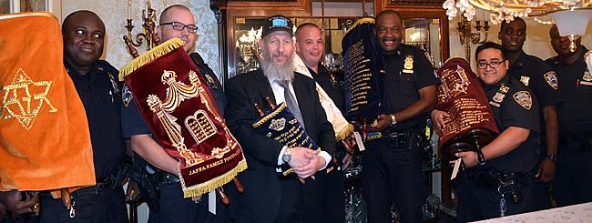 North America: Torah Scroll Honors Memories of Slain Dallas Police Officers