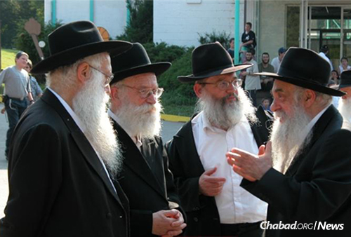 Rabbi Zweibel, left, with Rabbi Meir Tzvi Gruzman, Rabbi Zalman Gopin and Rabbi Yoel Kahn at the annual Yarchei Kallah gathering of leading Chabad-Lubavitch rabbis in Upstate New York.