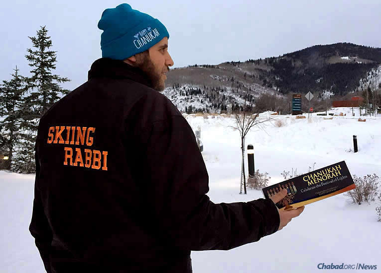 Rabbi Yudi Steiger, co-director of Chabad Lubavitch of Park City, Utah, has been handing out menorah kits at the ski slopes for residents and tourists, who flock to the area over winter break.