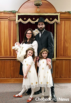 The Ceitlin family at the brit milah ceremony (Photo: Britta Van Vranken)