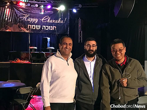 "Ceitlin with Keya Tehrani, left, and Darryl Wong before the start of ""Chanukah Night Out."""