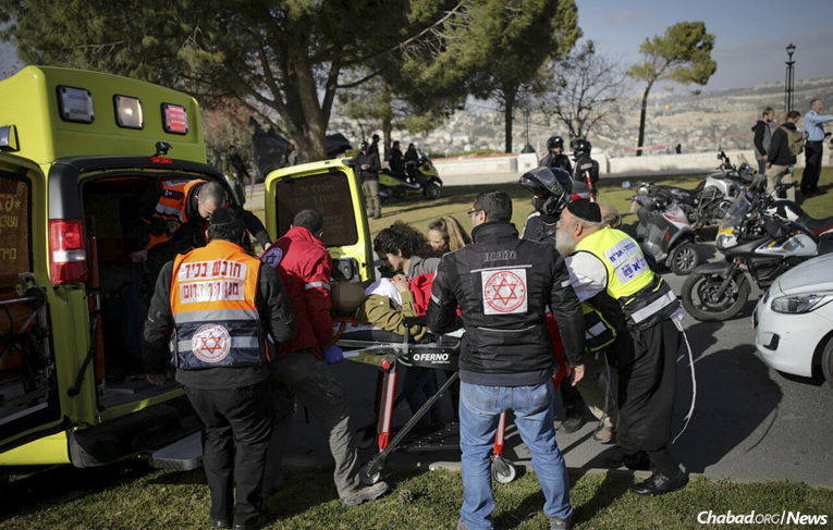 Emergency medical teams at the scene of a Jerusalem truck terror attack on Sunday that killed four young Israeli soldiers and injured 15. (Photo: Yonatan Sindel/Flash90)
