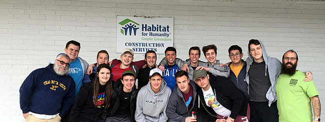 Photo Gallery: Greensboro, N.C., Chabad Volunteers at Habitat for Humanity