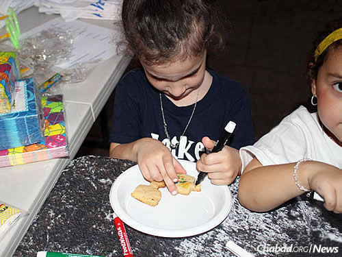 Children make decorations at Chanukah time.