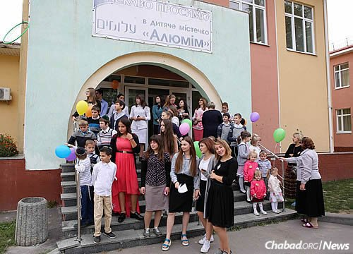 The Alumim Children's Home sits on an expansive educational campus in the nearby suburb of Zarichany. Here, some of the residents gather at the complex's main entrance.