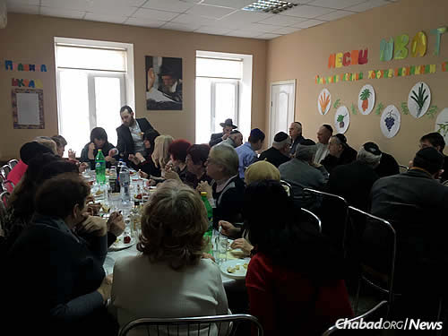 """A festive meal for a brit milah in Mariupol; two circumcisions have taken place recently. """"We have a job to do here,"""" insists Cohen."""