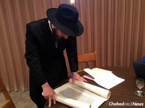 The rabbi reads the Megillah last year during Purim.