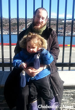 The rabbi with his son, whose first haircut, a public event, is planned for March 5.