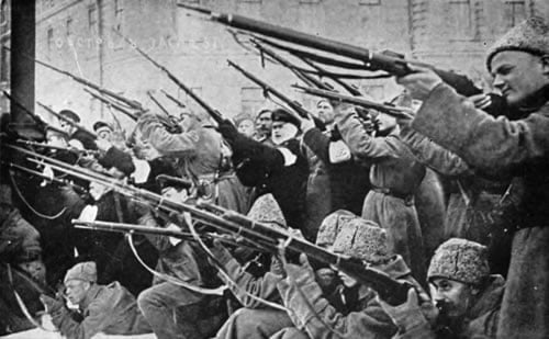 Revolutionaries take up arms against Tsarist police during the early days of the February Revolution in Petrograd.