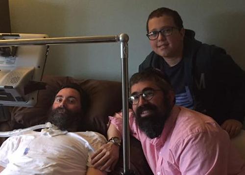 Rabbi Nechemia Schusterman and his son visit Rabbi Yitzi Hurwitz.