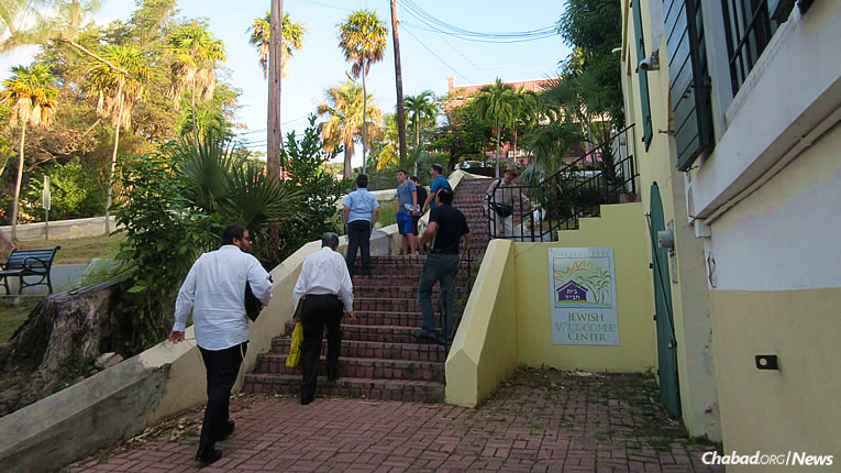 Walking up the steps for morning prayers in St. Thomas, led by Rabbi Asher Federman, director of Chabad Lubavitch of the Virgin Islands. (Photo: Howard Blas)