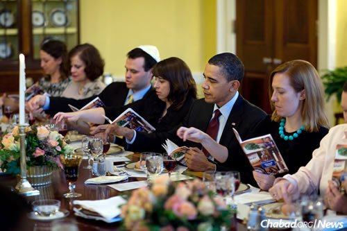 President Barack Obama marks the beginning of Passover at a seder with friends and staff in the White House on March 29, 2010. He hosted the inaugural White House seder the year before, on April 9, 2009, and held one annually throughout his administration. (White House Photo/Pete Souza)