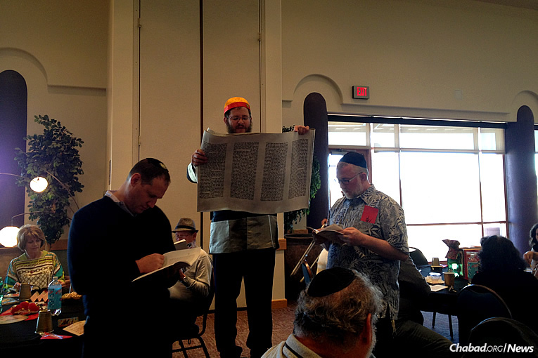 """Rabbi Mendy Lipskier, center, started the Jewish Recovery Fellowship of Arizona in 2012 and holds alcohol-free Purim parties in which the community also takes part. This year, the festivities take place on Sunday afternoon with a """"Purim in Russia"""" theme, complete with music by the Arizona Balalaika Orchestra."""