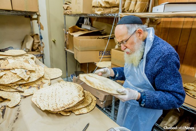 To meet a growing demand, matzah bakeries begin baking shmurah matzah as early as October, producing batches of the tasty discs for consumption the world over. (Photo: Eliyahu Parypa/Chabad.org)
