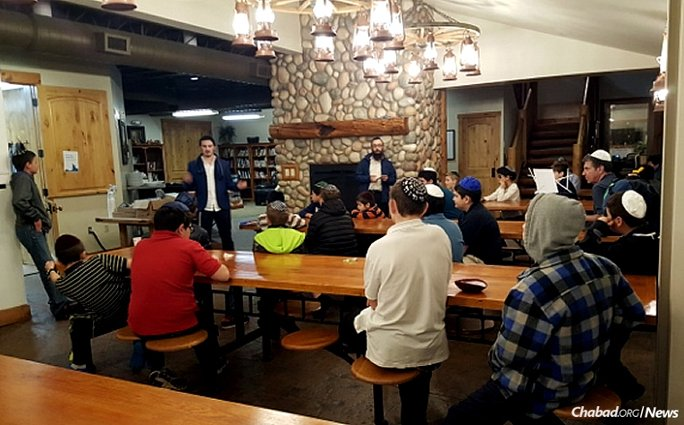 For 10 years now, Rabbi Mendel Lifshitz, center, director of Chabad Lubavitch of Idaho in Boise, has been serving as a mentor and friend to Jewish students attending Cherry Gulch, an Idaho-based therapeutic boarding school, infusing Jewish content into their week.