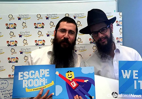 Rabbi Levi Kotlarsky, left, and Rabbi Yossi Cadaner of Merkos Suite 302 tested the project before it took off. (Photo: CKids)