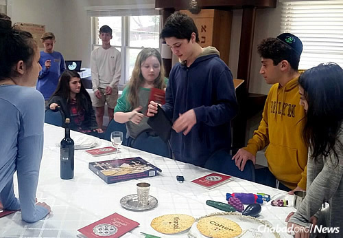 Participants need to solve clues and puzzles as a team to break out of the room and get free, a relevant theme as Passover approaches. (Photo: CKids)
