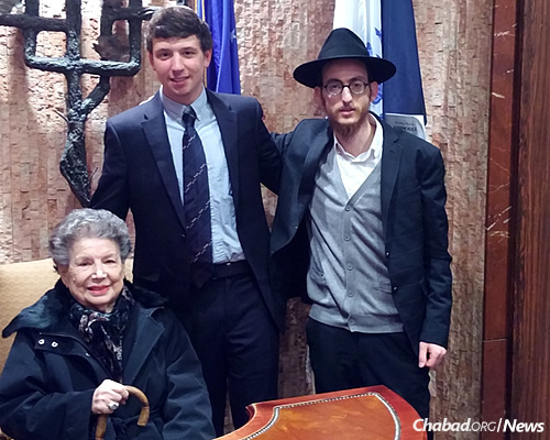 Arlene Kule, with her grandson and the rabbi, who she has known for 18 years