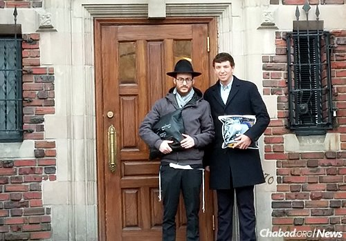 Rabbi Shalom Cunin, left, director of Chabad Westwood-Holmby in Los Angeles, and Reade Seiff, Kule's 18-year-old grandson, outside of Lubavitch World Headquarters in Brooklyn, N.Y. The two forged a bond based on the longtime friendship of Cunin and Kule.