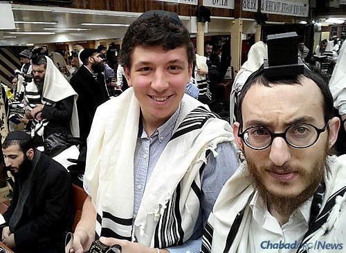 Seiff and Cunin during morning prayers at Lubavitch World Headquarters. After moving to California, the teen has been donning tefillin with Cunin on a daily basis and saying Kaddish for his grandfather.
