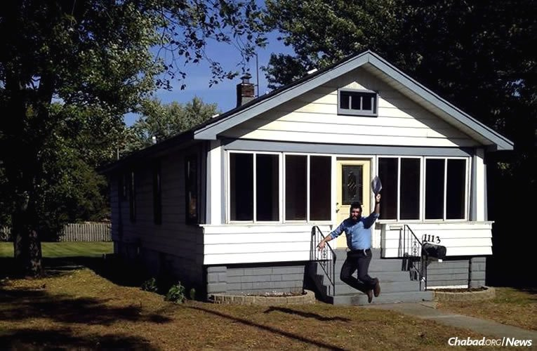Rabbi Eliezer Zalmanov, co-director of Chabad of Northwest Indiana with his wife, Chanie, jumps for joy back in October 2015, when this property was purchased for Chabad in the small town of Munster.