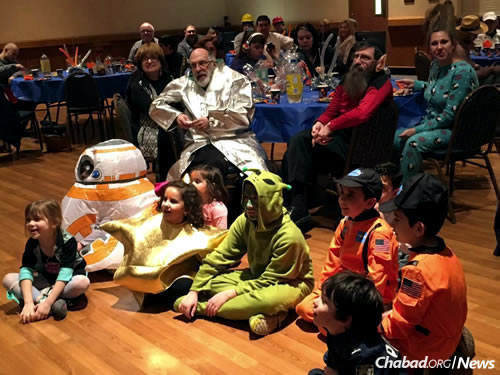 "Elizabeth Graves, far left, and other children at this year's ""Purim in Outer Space"" event."