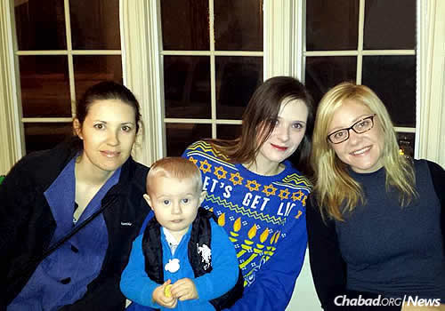 Sisters Shoshannah Aumock, Leah Kovtonenko (with her son, Niko) and Alisa Shortell at the annual menorah-lighting and Chanukah party.