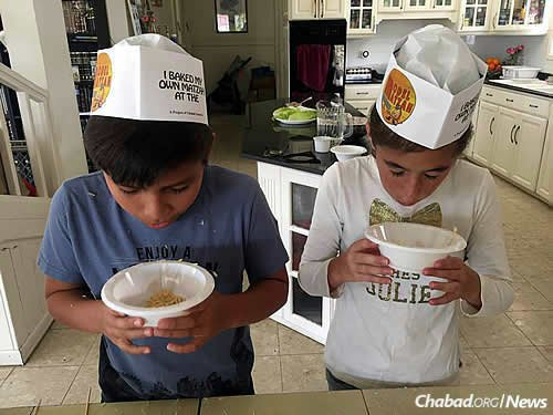 In Aruba, kids get ready to make their own matzah. An estimated 120 people are expected at Chabad-run seders there.