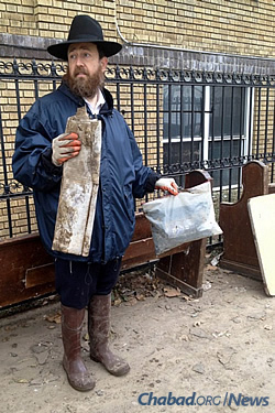 The rabbi in October 2012, post-Sandy, taking valuables out of the muddied synagogue.