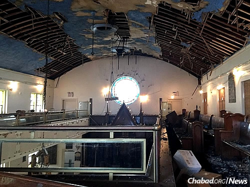 Though the synagogue exterior still stands, the interior is in shambles, filled with ruined prayerbooks, tallises and other spiritual items.